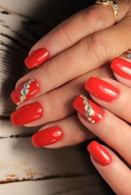 Medium length red nails with gem stones