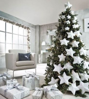 Nordic Christmas tree decorating with oversized white stars