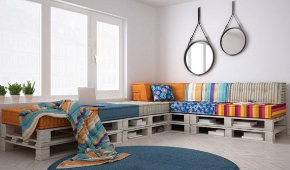 Repurpose wood pallets into a retro corner sofa