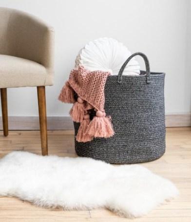 Rustic basket for blanket storage