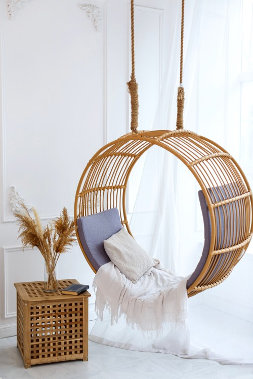 Scandinavian decor with swing chair and pampas grass ( your relaxing reading nook)