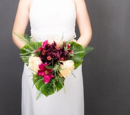 Tropical realistic artificial wedding bouquet, fuchsia burgundy peach flowers