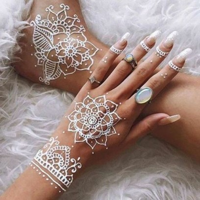 White traditional henna tattoo designs and opal ring
