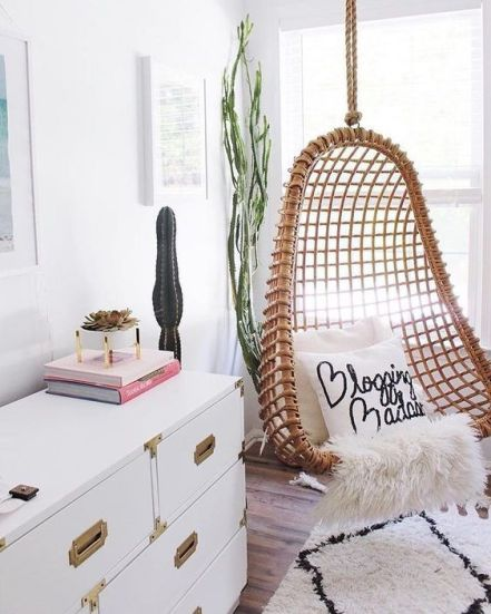 Rustic rattan hanging chair. cozy swinging chair for teenager bedroom