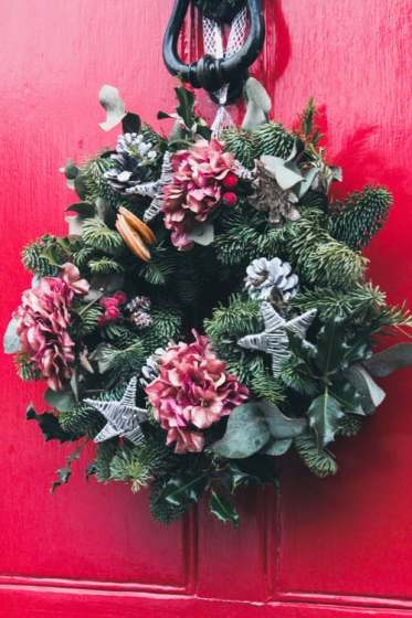 Evergreen Christmas wreath with silver stars and orange slices