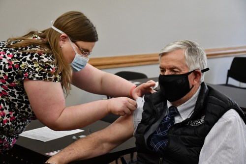 Gov. Mike Parson receives his second dose of the Pfizer vaccine at the Cole County Health Department