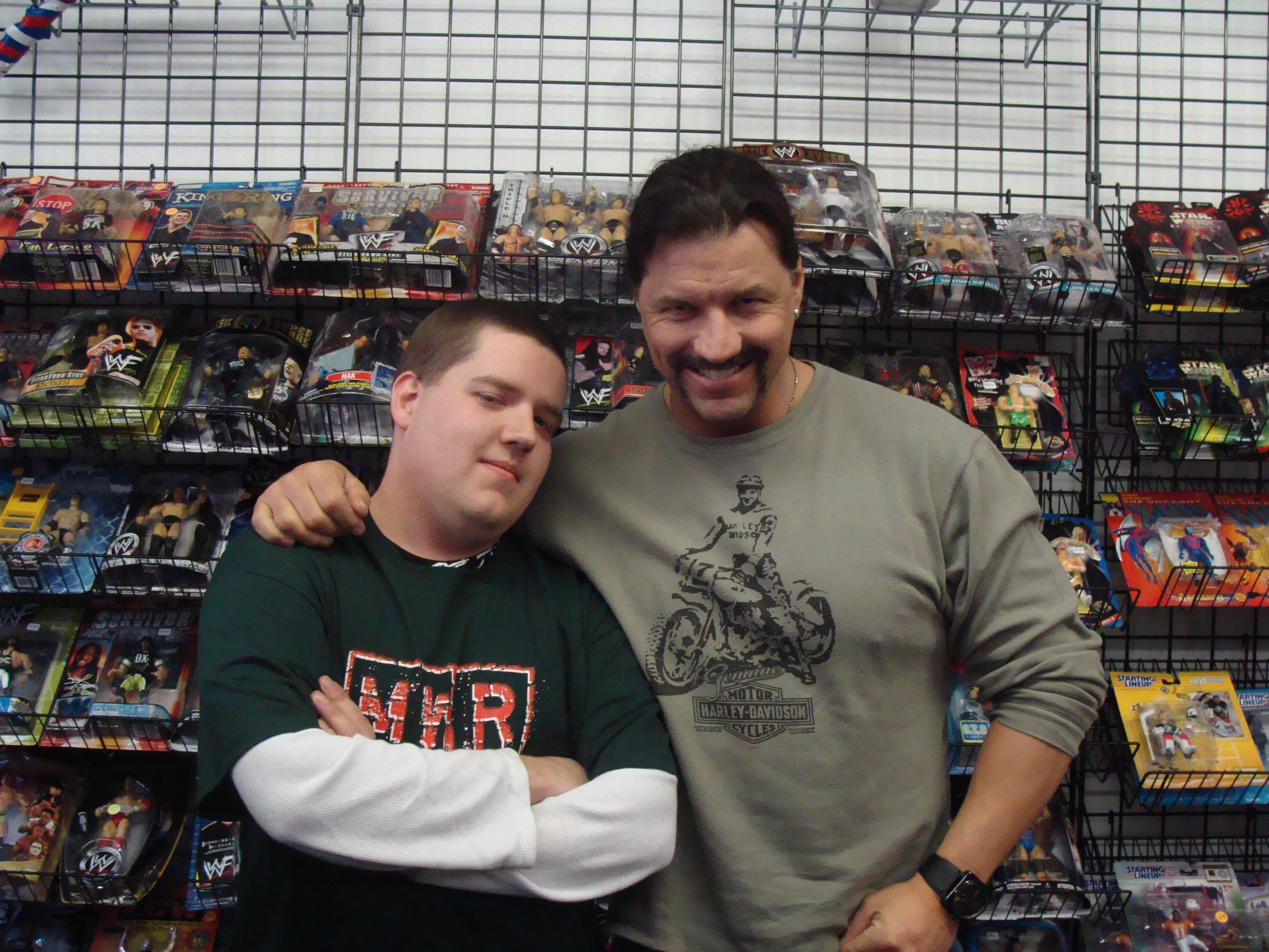 Paul Morad, the winner of the MWR T-shirt raffle poses with Al Snow, who appeared at The Fan Shop on Jan. 30.