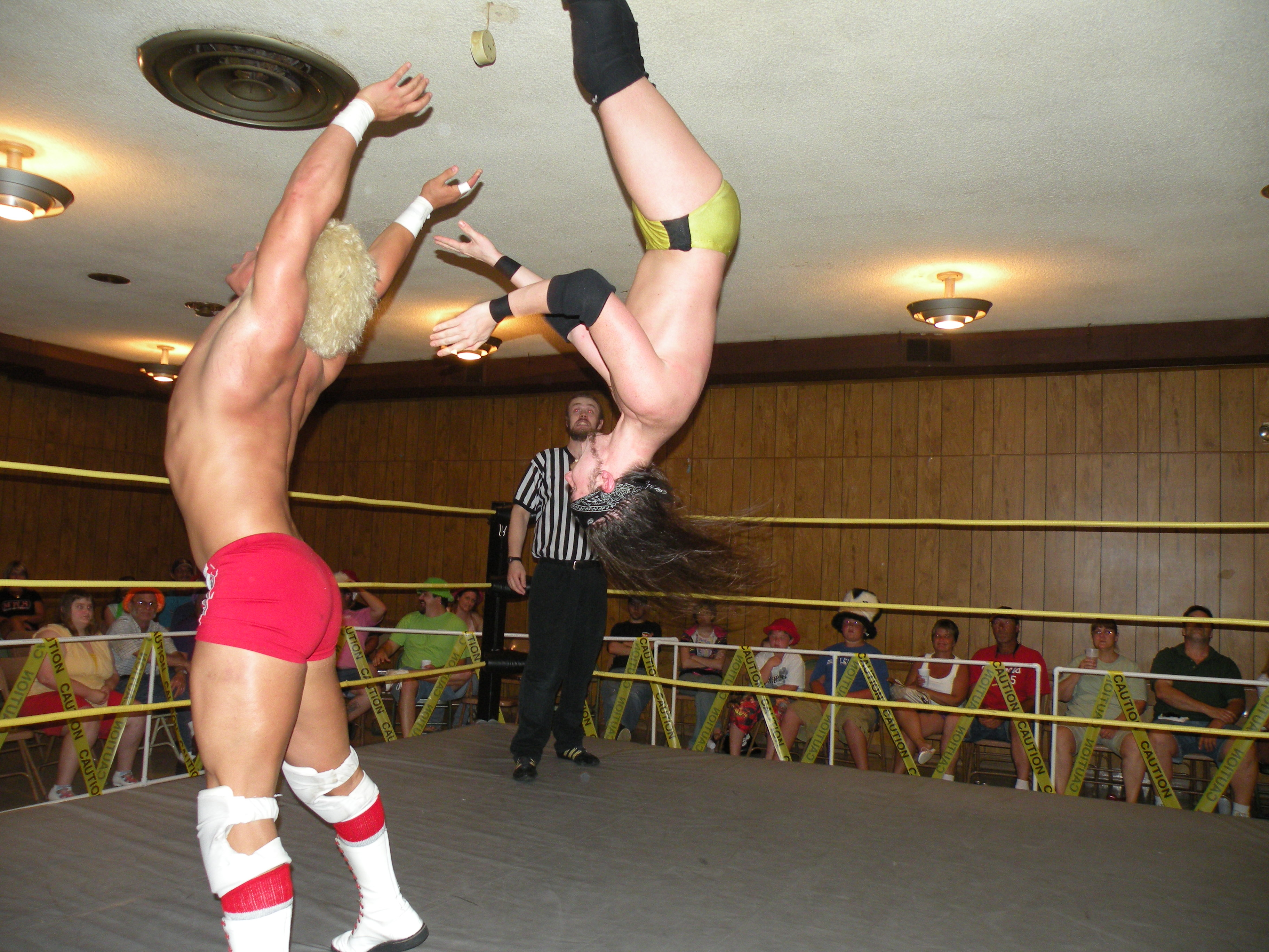"Knight Wanger is head over heels in his encounter with Juice Robinson. (Photo Credit Brian ""Flair"" Kelley)"