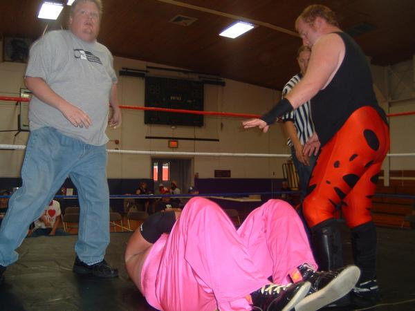"""JC Michaels and Jaxson Pride double team Rex Gill after the match.(Photo Credit Brian """"Flair"""" Kelley)"""