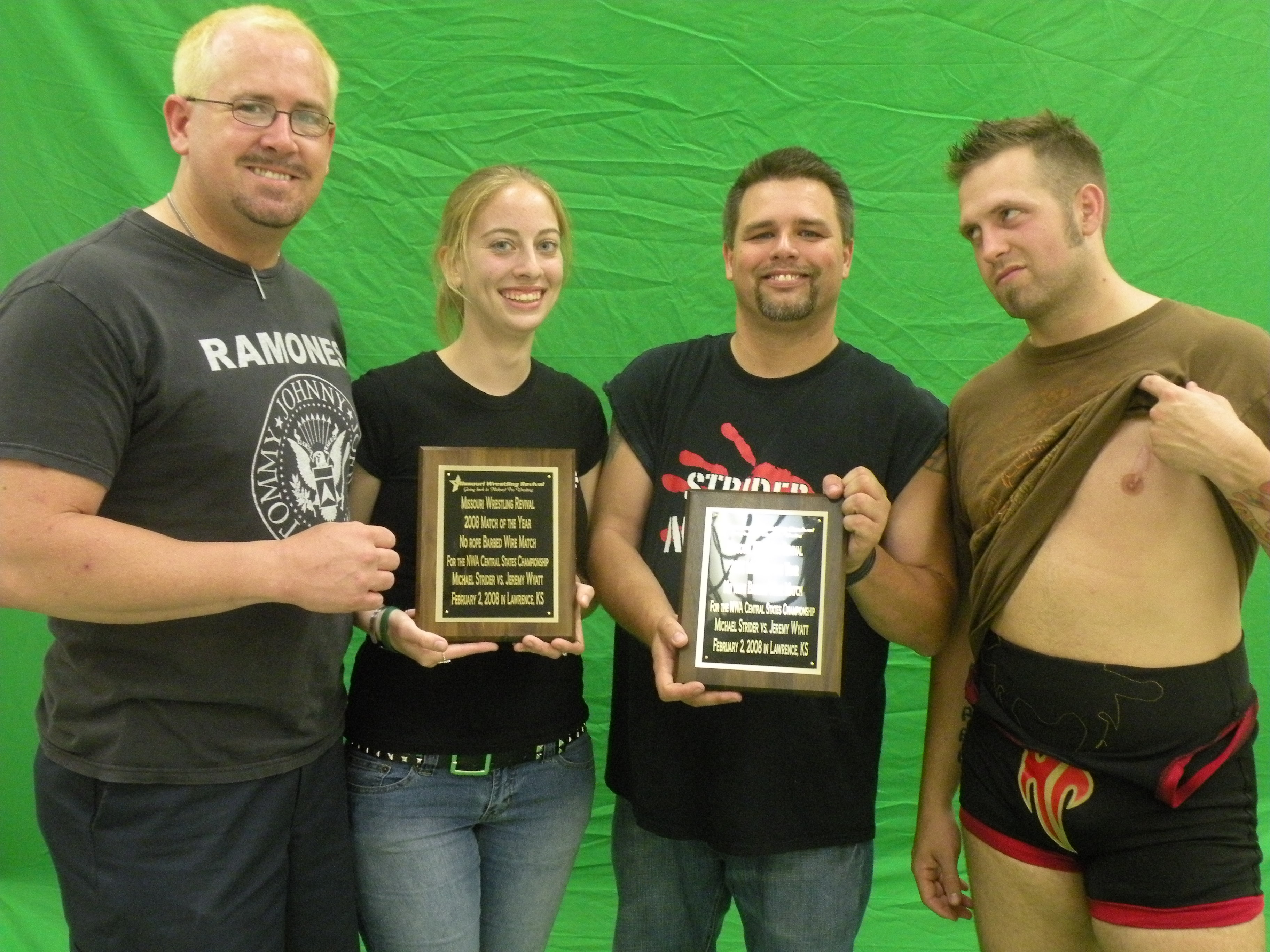 """A reunion between two warriors of the sport as Michael Strider and Jeremy Wyatt receive their 2008 MWR Match of the Year plaques. Pictured left to right Michael Strider, MWR Columnist Kari Williams, MWR Owner Brian Kelley, Jeremy """"The Belt Collector"""" Wyatt."""