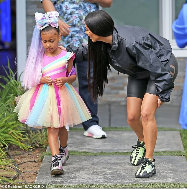 North West rocks purple extensions for music video shoot