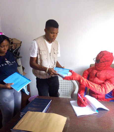 'Spider Man' Lecturer Excites His Final Year Students As He Signs Their Projects