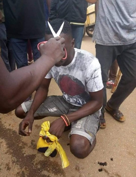 Niger State Taskforce Shaves Men's Hair With Scissors By Force (Photos)