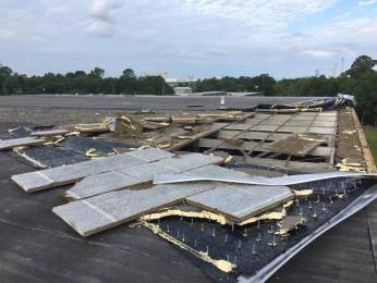 A Friday night tornado sucked the roof off of a large portion of the City Recreation Department_s gym on Pascagoula Street. Pascagoula Recreation Department
