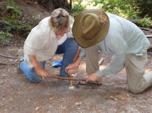 Dan showing our Sister in Crime Jenny Carless how to make a friction fire.