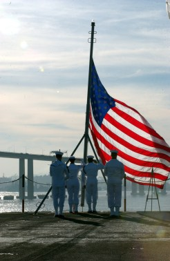 flag at half mast; sailor ssaluting