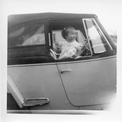 small child in old car