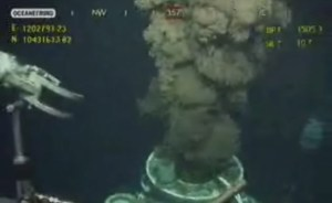 This image from video provided by BP PLC early Sunday, July 11, 2010 shows oil continuing to leak after the flange was removed from atop the broken wellhead, at the site of the Deepwater Horizon oil well in the Gulf of Mexico. (AP Photo/BP PLC) NO SALES