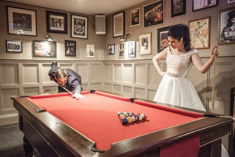 Bride and Groom play pool