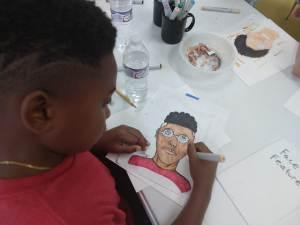 Boy drawing a self portrait