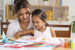 mother drawing a picture with her daughter