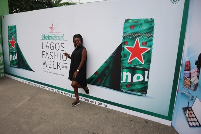 Stading in front of the Heineken banner