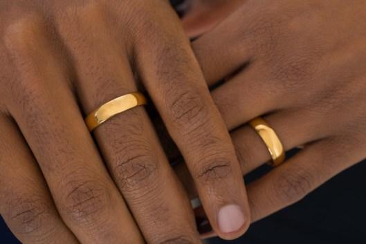 Hands Wearing Golden Rings