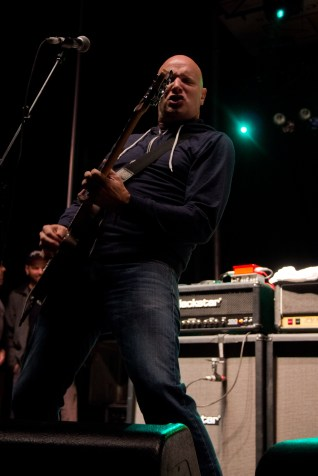 Guitarist for the Descendents showing off after fixing his guitar string.
