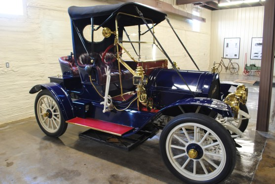 The 1911 Mitchell 3-Passenger Roadster has cushioned seats for two inside under the top cover and an open air seat on the back of the car as well. If a third person wasn't traveling that day, the third back seat could be refitted like a trunk to carry groceries or a small suitcase for trips!