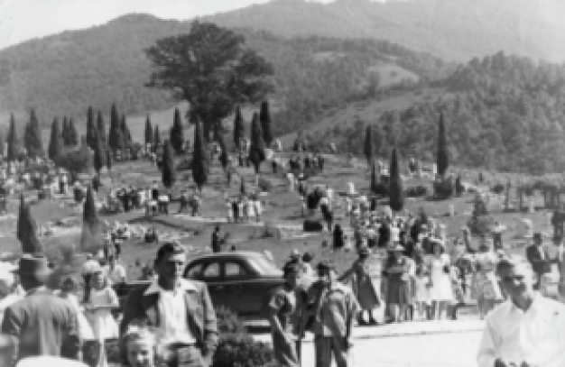 Decoration day at the Bear Creek Baptist Church Cemetery is set on the fourth Sunday in June of every year. This photograph was taken in the 1930's. Today Bear Creek Cemetery contains over 1,700 graves. Allen Sparks was the first person buried at Bear Creek in 1849.