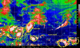 Color-enhanced infrared satellite imagery of 10 June 2014 showing INVEST 94W, a low pressure system being monitored for possible cyclonic development over the northern Philippines Sea. Other disturbed weather cells over the larger region are also shown.