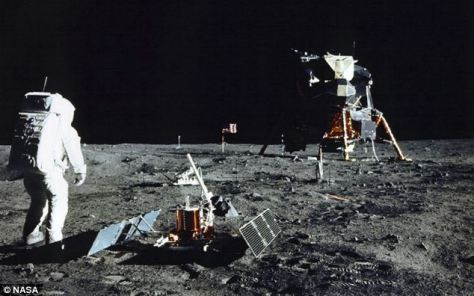 """The Lunar Module 'Eagle' in the background ready to blast-off to take Commanders Armstrong and Aldrin back to the orbitting command/service module 'Columbia"""" and pilor Michael Collins for their return to our spaceship Earth"""