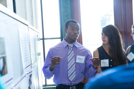 Architecture student Omotoyosi Oyedeji of Hyde Park, Massachusetts explains his team's project. Oyedeji, Evelyn Ortiz of San Jose, CA, Flavia Cuervo of Hialeah, FL, and Christian Taveras of Lawrence, MA used opaque plastic to model a modern take on the phone booth for cell phone users.