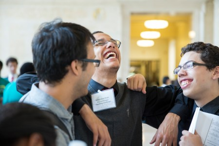 Digital Design Teaching Assistant Johnathon Root, who participated in MITES in 2011, shares a laugh with Symposium participants.