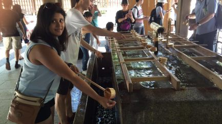 Cleaning hands before entering the shrine area