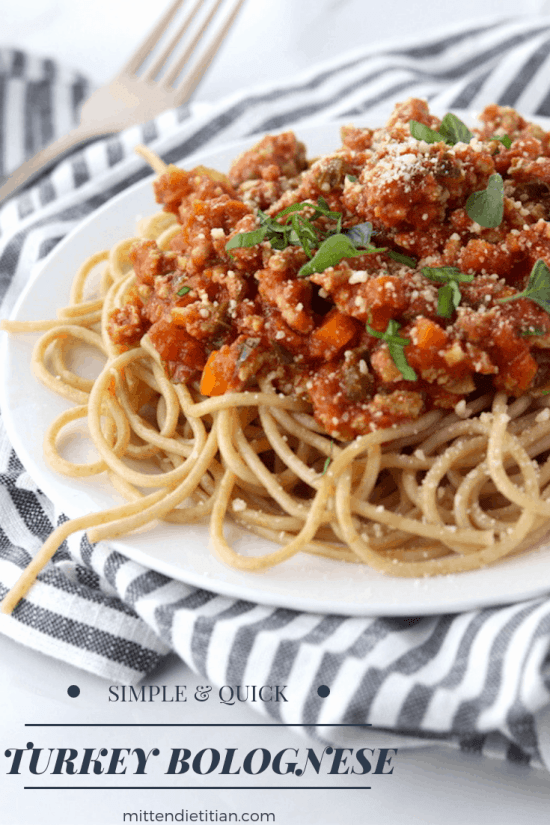 This simple & quick turkey bolognese is a great healthy weeknight dinner. It's low fat, loaded with veggies and high protein!