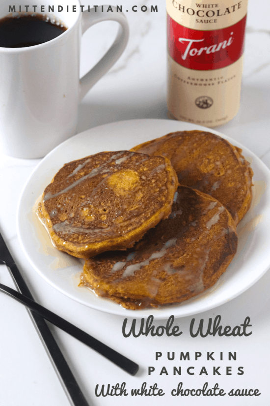 Easy healthy and delicious whole wheat pumpkin pancakes with white chocolate sauce! SO easy! #healthy #easy #pumpkinpancakes #pancakes #pumpkin #whitechocolate