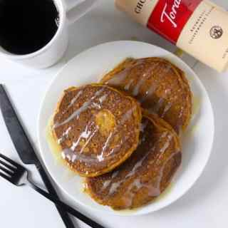 Whole wheat pumpkin pancakes with white chocolate sauce