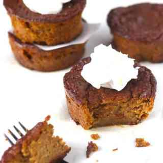 gluten & dairy free mini pumpkin pies eaten with a fork