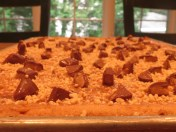 Drizzle over cooled baked blondie layer and top with toffee and ground peanuts