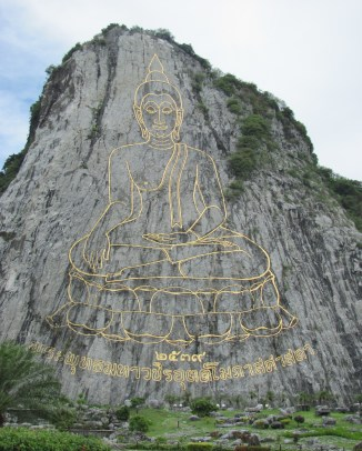The Buddha image is carved out of the cliff face on this mountain by laser beams.