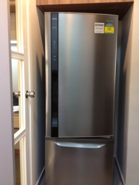Our fridge standing in it's place. I wonder what would happen if we stuck to the bigger LG fridge we bought earlier.
