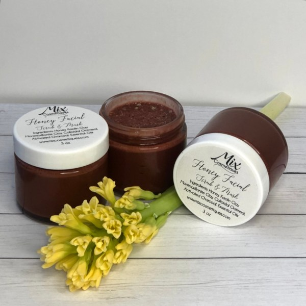 honey pampering facial scrub and mask with open jar to show texture, color and consistency made with organic local honey
