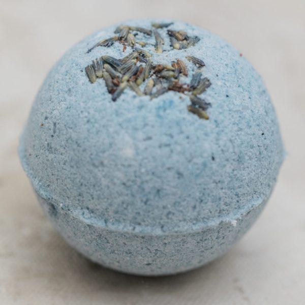 Lavender vanilla bath bomb with lavender buds indigo color and essential oils of lavender, vanilla and bergamot
