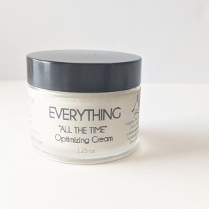 everything all day cream in glass jar contains sun protection and peptides