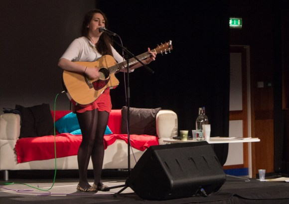 Yasmin Davey-Corrigan plays acoustic set at Solent Smile festival conference.