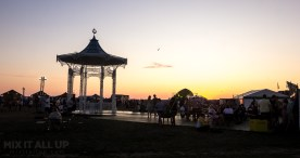 Sunday evening sunset at Victorious Festival 2019 featuring Southsea Bandstand and the Seaside Stage in the distance