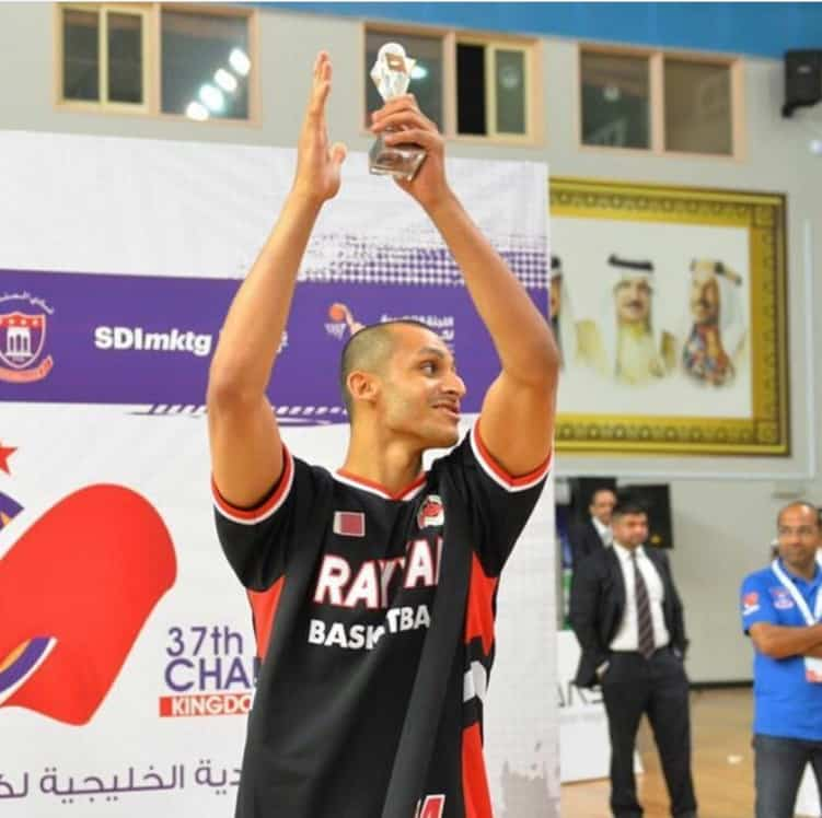 Mizo Amin holding best 3 point shooter in the gulf region trophy Bahrain