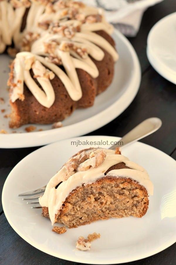 A slice of chai Bundt cake ready to be enjoyed. | mjbakesalot.com