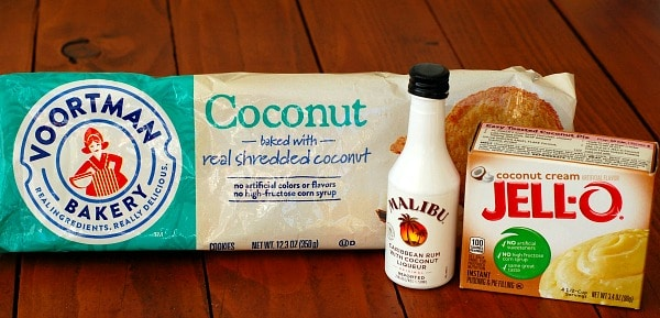 Piña colada pie starts with a crust made from coconut cookies, then dry instant pudding mix is added to the filling and coconut rum is used in both the filling and the topping. | mjbakesalot.com